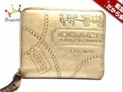 COACH(コーチ) 2つ折り財布 - ゴールド ラウンドファスナー/型押し加工 レザー